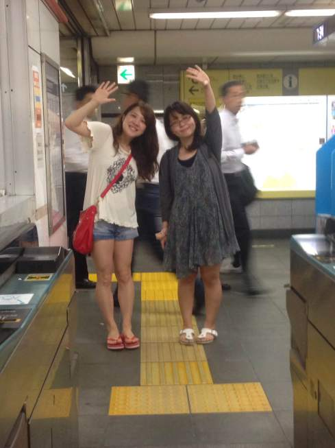 Ayako and Nachi waving good bye on my way to the airport.